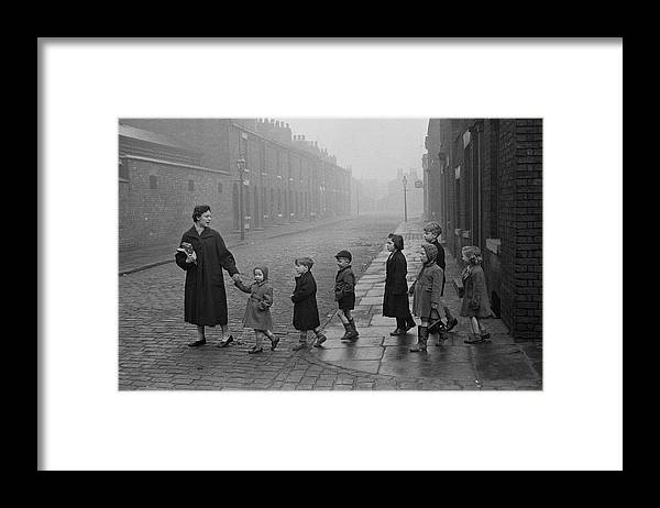 Following Framed Print featuring the photograph Teacher And Pupils In Manchester by Bert Hardy