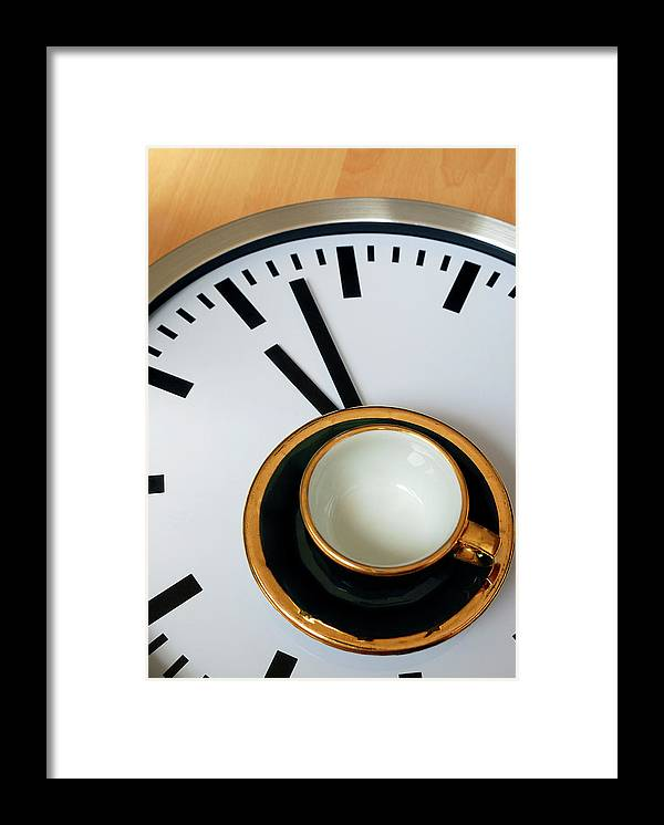Coffee Framed Print featuring the photograph Teacup On A Clock by Eversofine