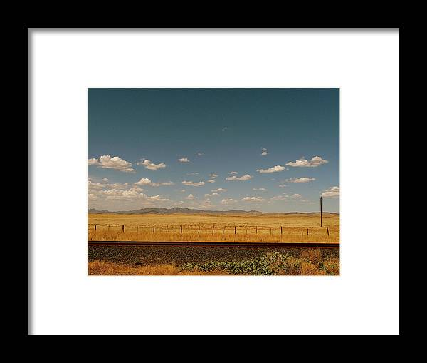 Tranquility Framed Print featuring the photograph Texan Desert Landscape And Rail Tracks by Papilio