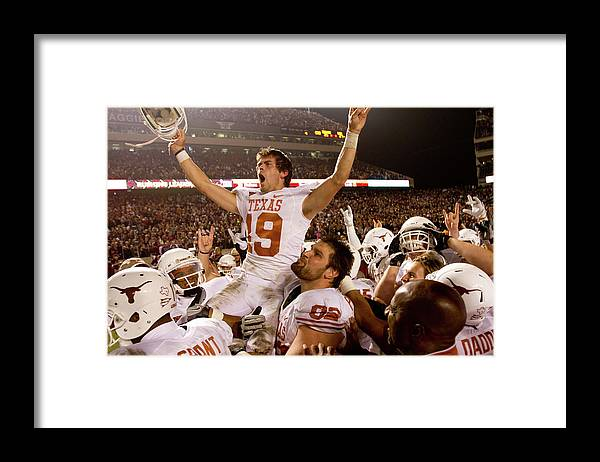 College Station Framed Print featuring the photograph Texas V Texas A&m by Darren Carroll