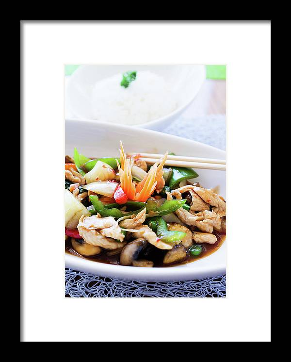 Chicken Meat Framed Print featuring the photograph Thai Basil Chicken Dish And Bowl Of by Rapideye