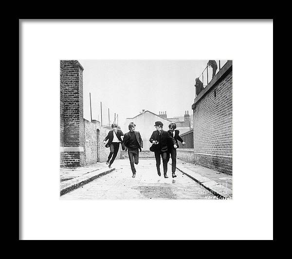 People Framed Print featuring the photograph The Beatles Running In A Hard Days Night by Bettmann