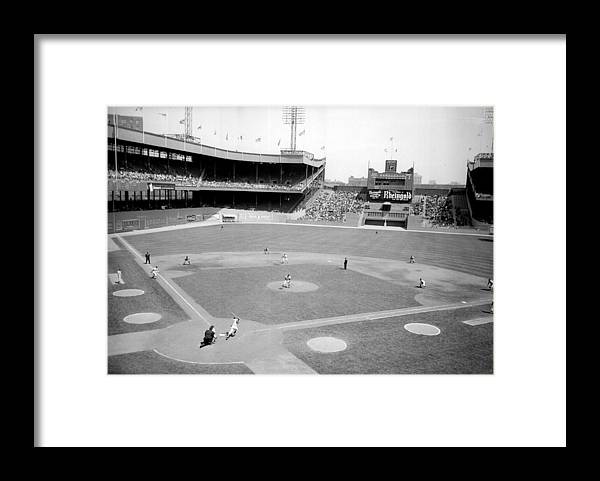 American League Baseball Framed Print featuring the photograph The Boston Braves And The New York Mets by New York Daily News Archive