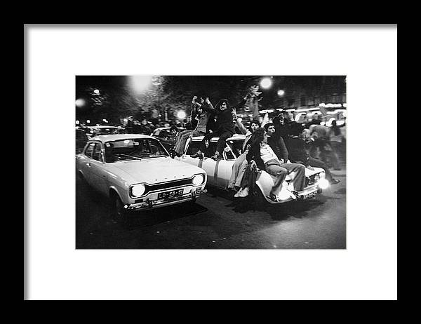The End Framed Print featuring the photograph The Carnation Revolution In Lisbon by Herve Gloaguen