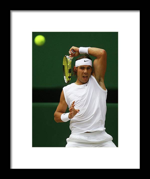 Rafael Nadal Framed Print featuring the photograph The Championships - Wimbledon 2008 Day by Julian Finney