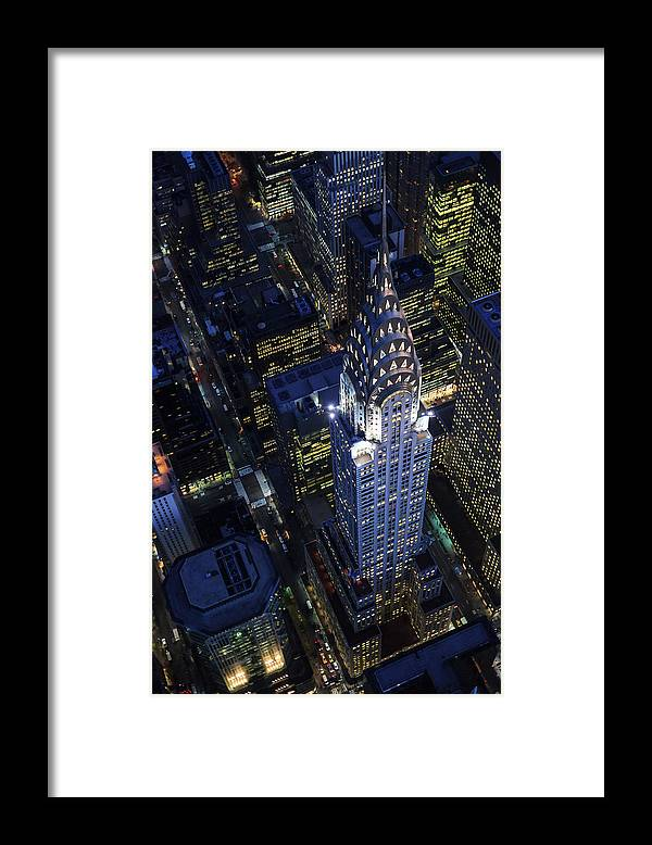 Downtown District Framed Print featuring the photograph The Chrysler Building And Manhattan by Berthold Trenkel
