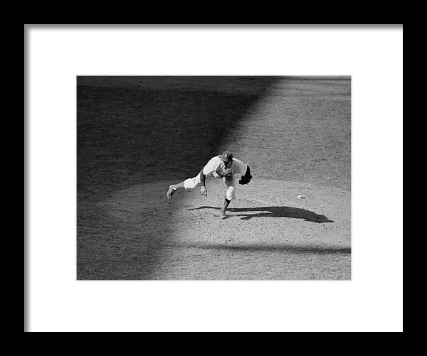Motion Framed Print featuring the photograph The Dodgers Hal Gregg, In Action In The by New York Daily News Archive