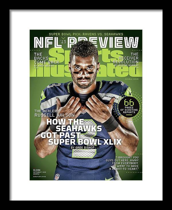 Magazine Cover Framed Print featuring the photograph The Healer Russell Wilson 2015 Nfl Football Preview Issue Sports Illustrated Cover by Sports Illustrated