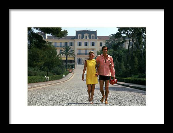 Heterosexual Couple Framed Print featuring the photograph The Jourdans by Slim Aarons