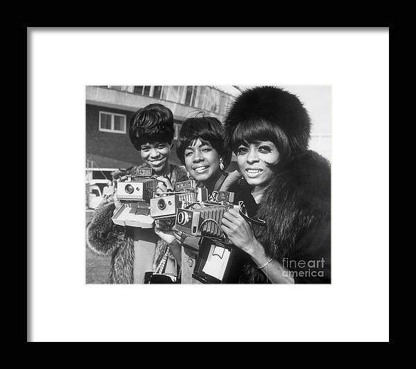 Singer Framed Print featuring the photograph The Supremes With Cameras In London by Bettmann