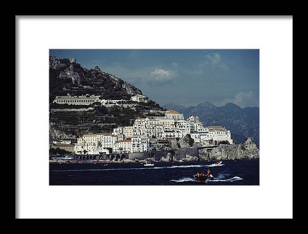 1980-1989 Framed Print featuring the photograph The Town Of Amalfi by Slim Aarons