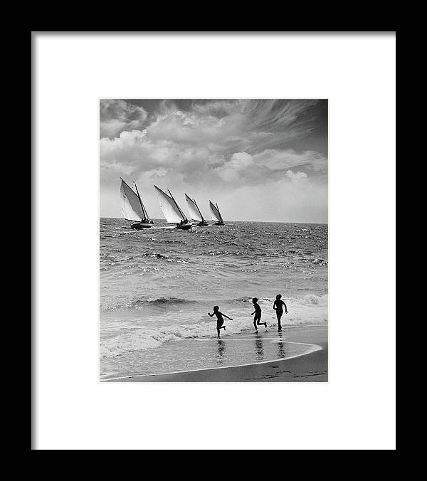 Following Framed Print featuring the photograph Three Boys Running Along Beach by Stockbyte