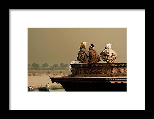 Water's Edge Framed Print featuring the photograph Three Sadhus Meditating By The Yamuna by Globalstock
