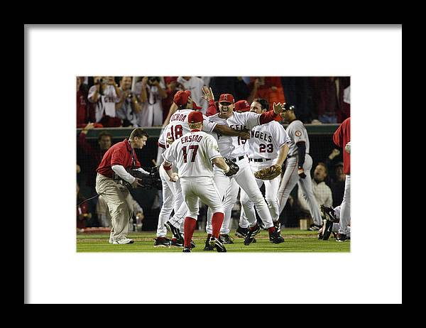Alex Ochoa Framed Print featuring the photograph Tim Salmon, Darin Erstad And Alex Ochoa by Jeff Gross