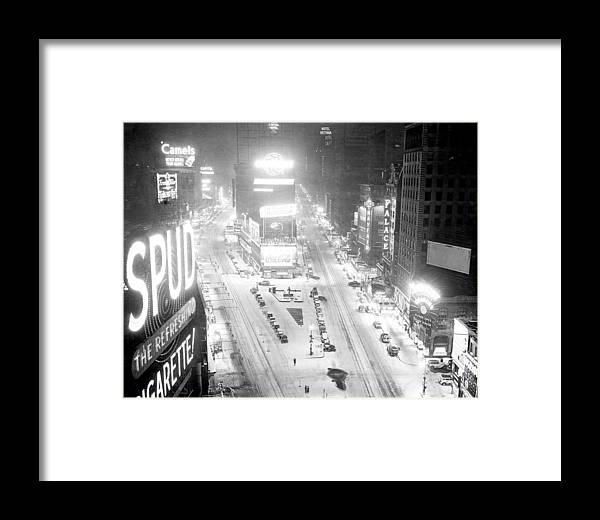 1930-1939 Framed Print featuring the photograph Times Square Is Covered In A White by New York Daily News Archive