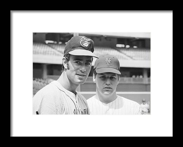 Tom Seaver Framed Print featuring the photograph Tom Seaver And Jim Palmer At Baseball by Bettmann