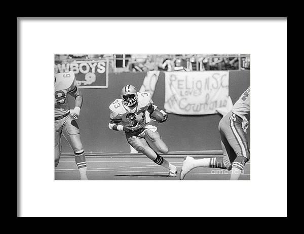 1980-1989 Framed Print featuring the photograph Tony Dorsett Running With Football by Bettmann