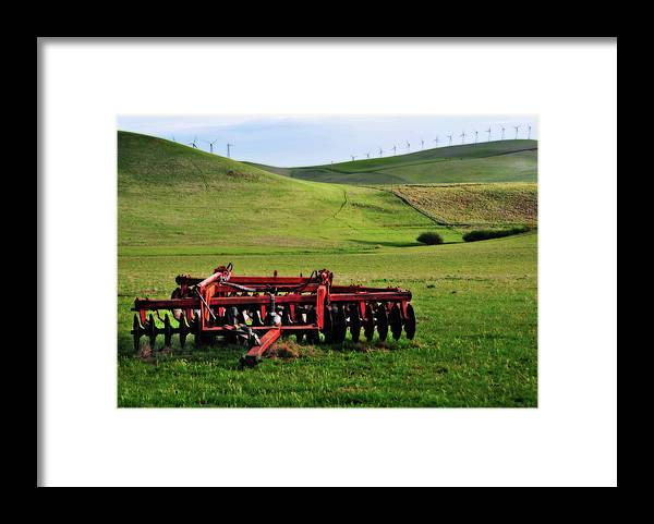 Working Framed Print featuring the photograph Tractor Blades On Green Pasture by Mitch Diamond