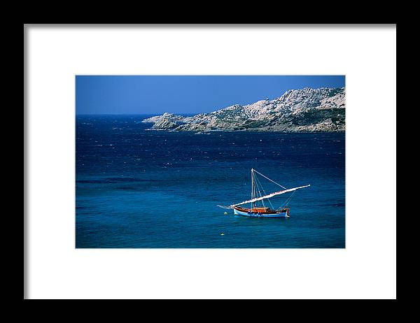 Sailboat Framed Print featuring the photograph Traditional Sailboat On Rocky Coast Of by Dallas Stribley
