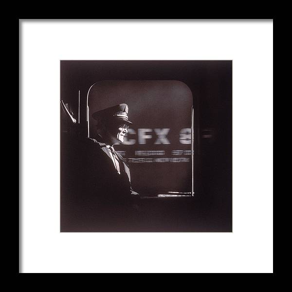 Working Framed Print featuring the photograph Train Conductor Looking Out Of Window by John Coletti