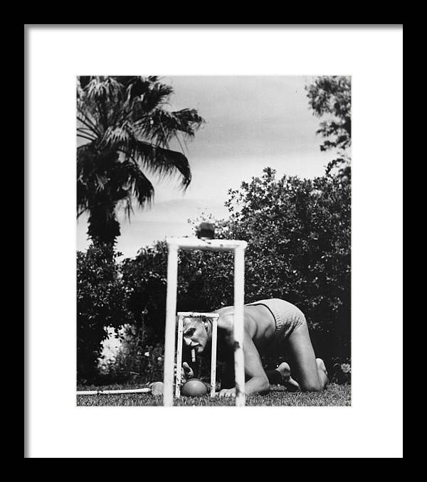 Darryl F. Zanuck Framed Print featuring the photograph Tricky Shot by Slim Aarons