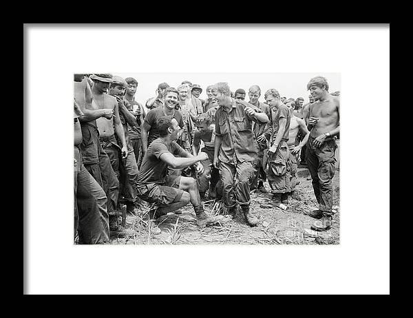Vietnam War Framed Print featuring the photograph Troops Watch Soldiers Dance by Bettmann