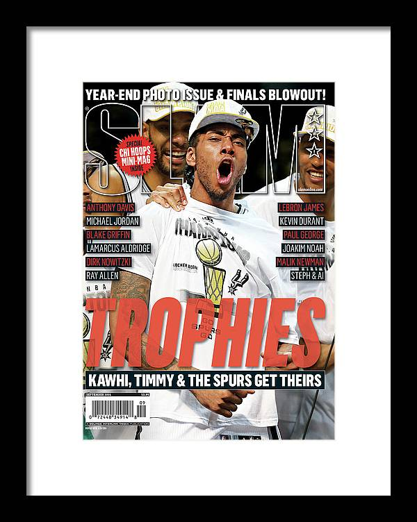 Kawhi Leonard Framed Print featuring the photograph Trophies: Kawhi, Timmy & The Spurs Get Theirs SLAM Cover by Getty Images