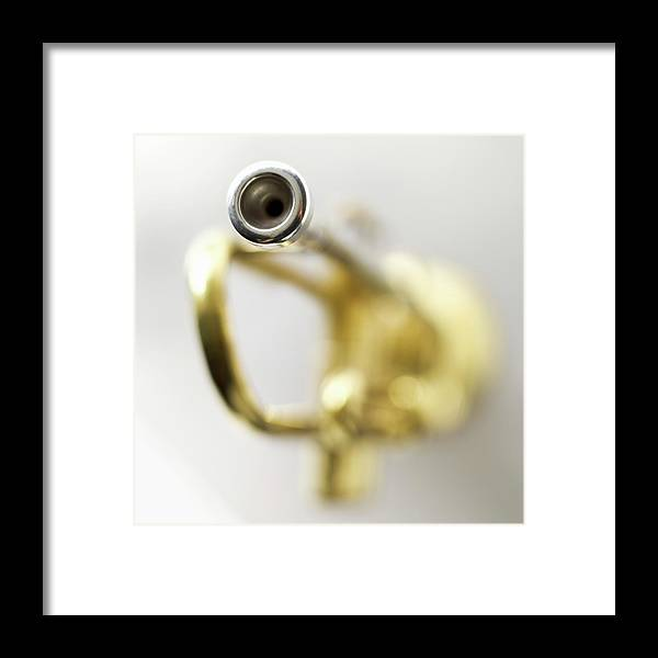White Background Framed Print featuring the photograph Trumpet, Focus On Mouth Piece by Stockbyte