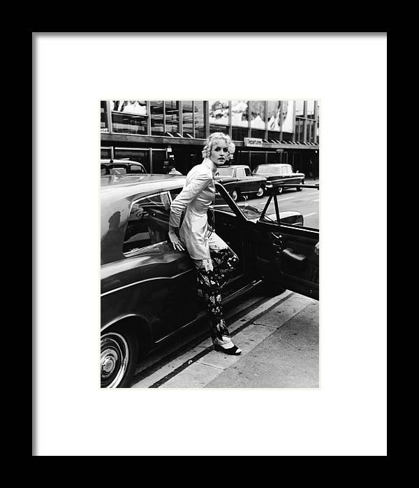 Rolls Royce Framed Print featuring the photograph Twiggy Steps From Rolls by Express Newspapers
