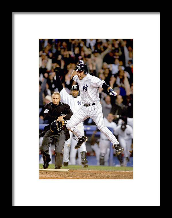 Game Two Framed Print featuring the photograph Twins V Yankees by Al Bello