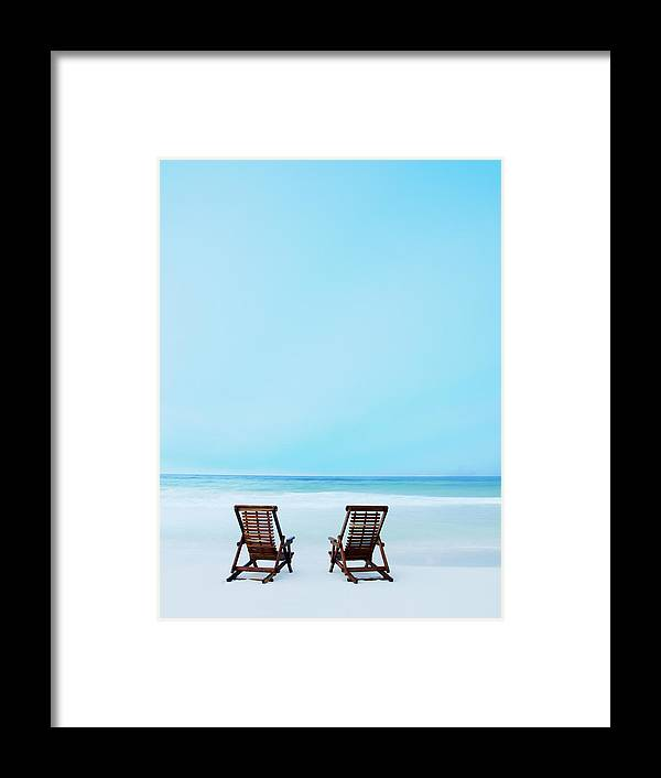 Dawn Framed Print featuring the photograph Two Beach Chairs On Tropical Beach At by Thomas Barwick