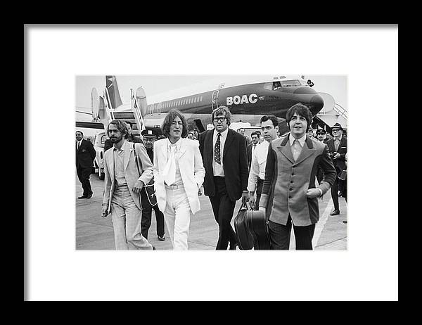 Following Framed Print featuring the photograph Two Beatles Arrive In New York by Fred W. McDarrah