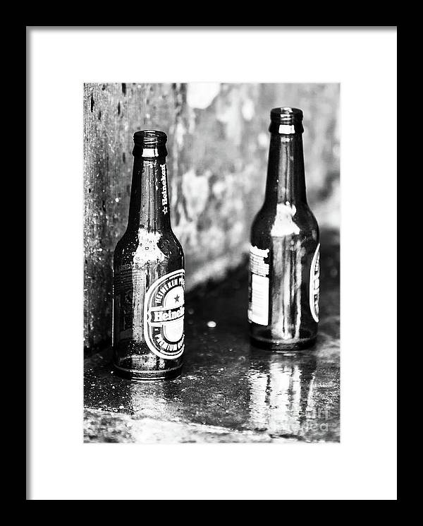 Two Heinekens In Amsterdam Framed Print featuring the photograph Two Heinekens In Amsterdam by John Rizzuto