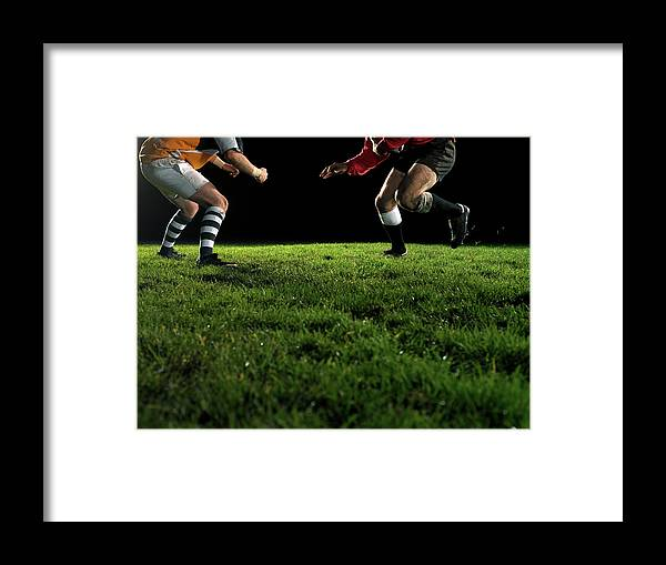 Grass Framed Print featuring the photograph Two Opposing Rugby Players, One Holding by Thomas Barwick