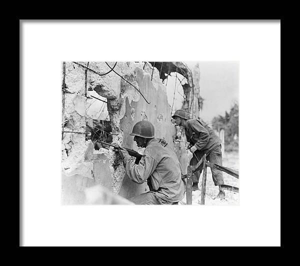 Rifle Framed Print featuring the photograph Two Soldiers With Rifles Behind Trees by Bettmann