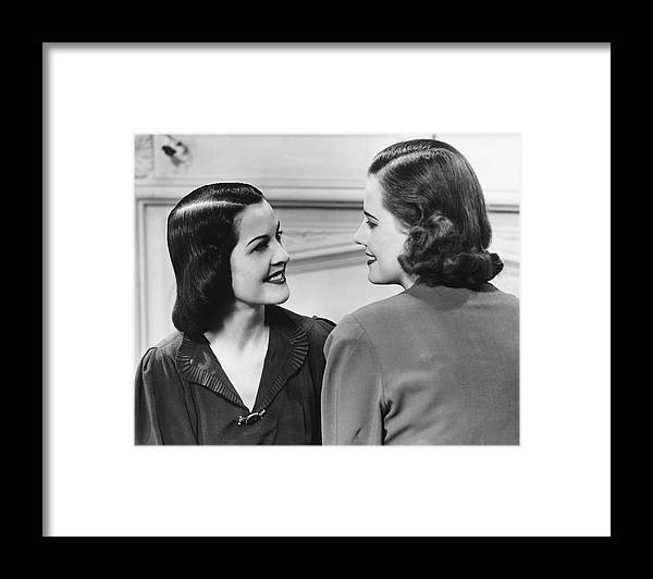 People Framed Print featuring the photograph Two Women Conversing In Living Room, B&w by George Marks