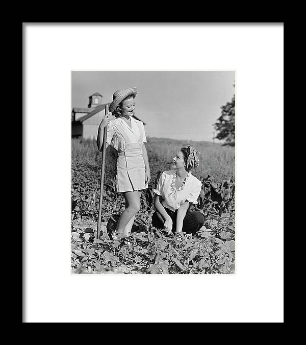 People Framed Print featuring the photograph Two Women Gardening In Field by George Marks