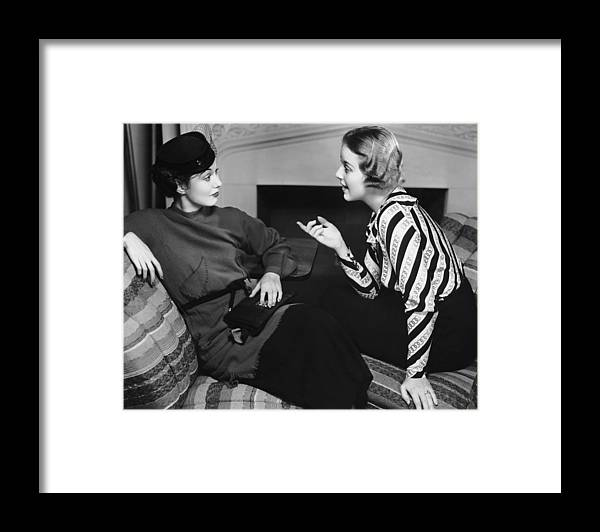 Three Quarter Length Framed Print featuring the photograph Two Women In Casual Conversation by George Marks