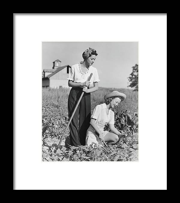 Straw Hat Framed Print featuring the photograph Two Women Working On Field, B&w by George Marks