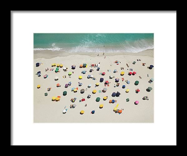 People Framed Print featuring the photograph Umbrella Pattern On Beach by Roger Wright