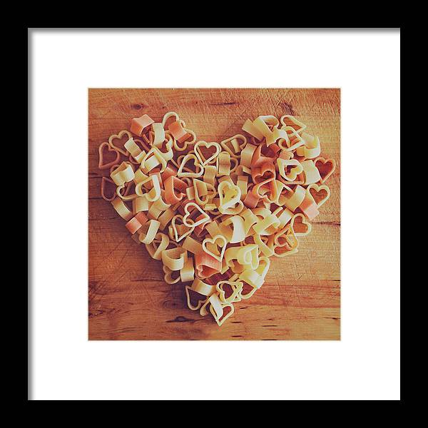 Italian Food Framed Print featuring the photograph Uncooked Heart-shaped Pasta by Julia Davila-lampe