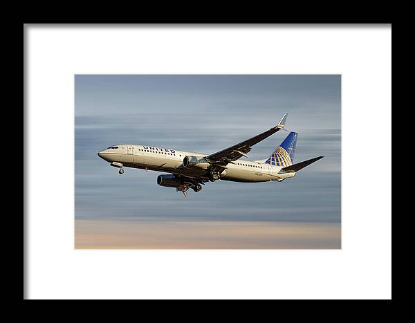 United Airlines Framed Print featuring the mixed media United Airlines Boeing 737-824 by Smart Aviation