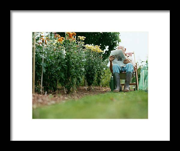 Grass Framed Print featuring the photograph Unrecognisable Man Sits Reading A by Iain Crockart