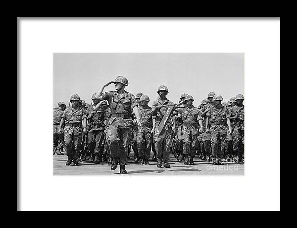 Marching Framed Print featuring the photograph U.s. Marines Marching In Review by Bettmann