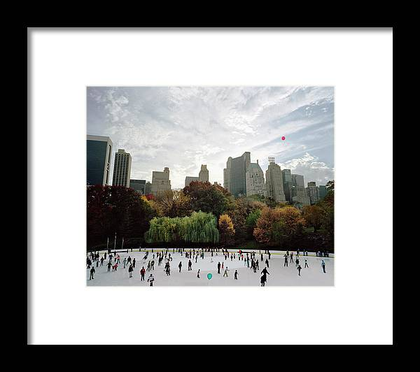 Child Framed Print featuring the photograph Usa, New York City, People Ice Skating by Carl Lyttle