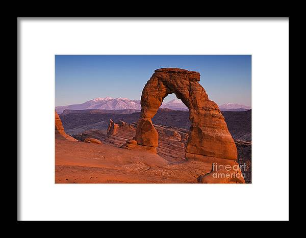 Arid Framed Print featuring the photograph Utahs Delicate Arch At Dusk by Andrew S