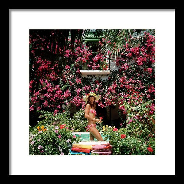 Straw Hat Framed Print featuring the photograph Valerie Cates by Slim Aarons