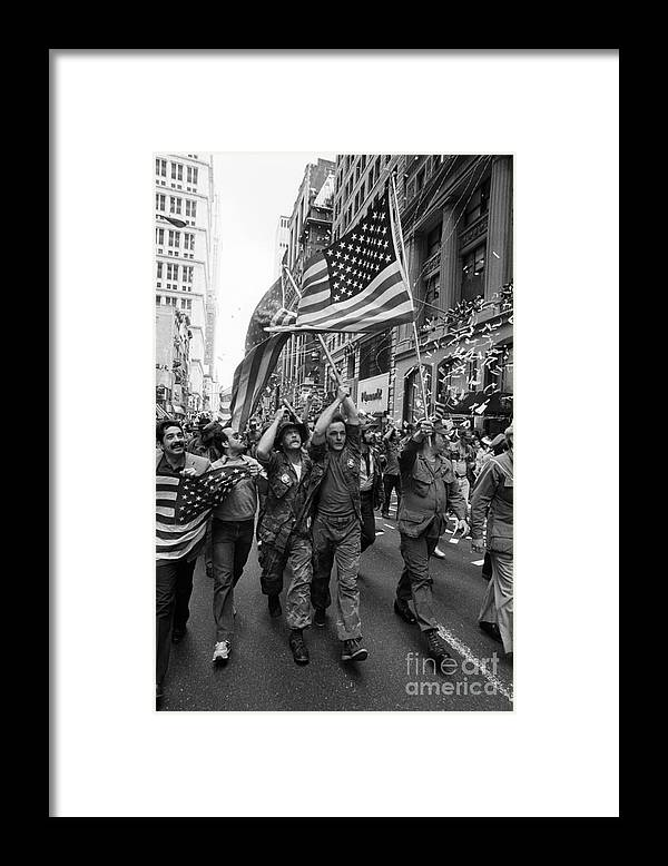 Marching Framed Print featuring the photograph Vietnam Veterans Parade On Broadway by Bettmann