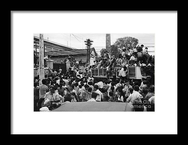Ho Chi Minh City Framed Print featuring the photograph Vietnamese Civilians Crowding In Front by Bettmann