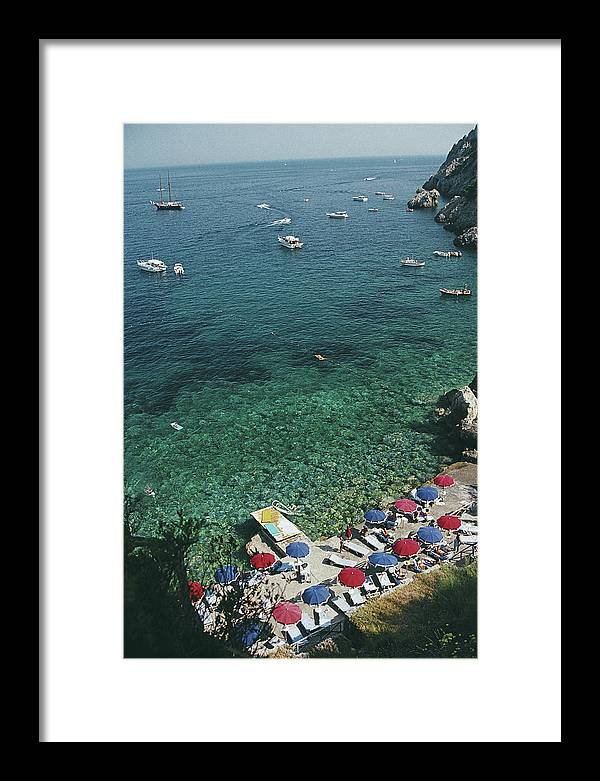 Sunbathing Framed Print featuring the photograph View From Il Pellicano by Slim Aarons